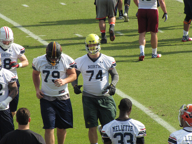 Kyle Long and Eric Fisher of North offensive line.